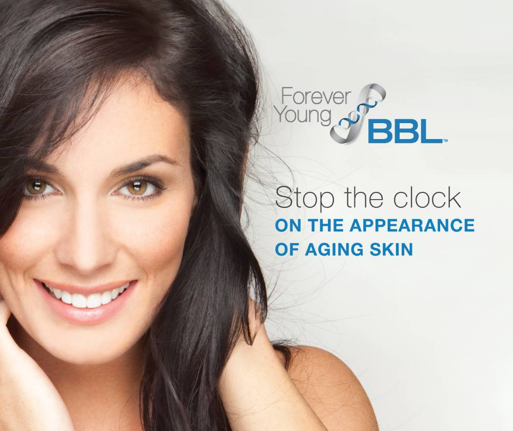 stock image of a female model smilimg by holding hands on face - Forever young bbl